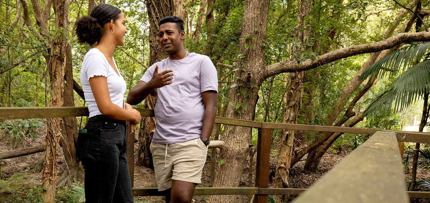 young man and woman chatting on forest walk 2