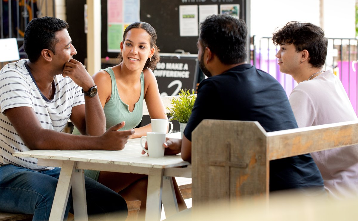 group_mentoring_table_discussion_outside home page mobile.jpg