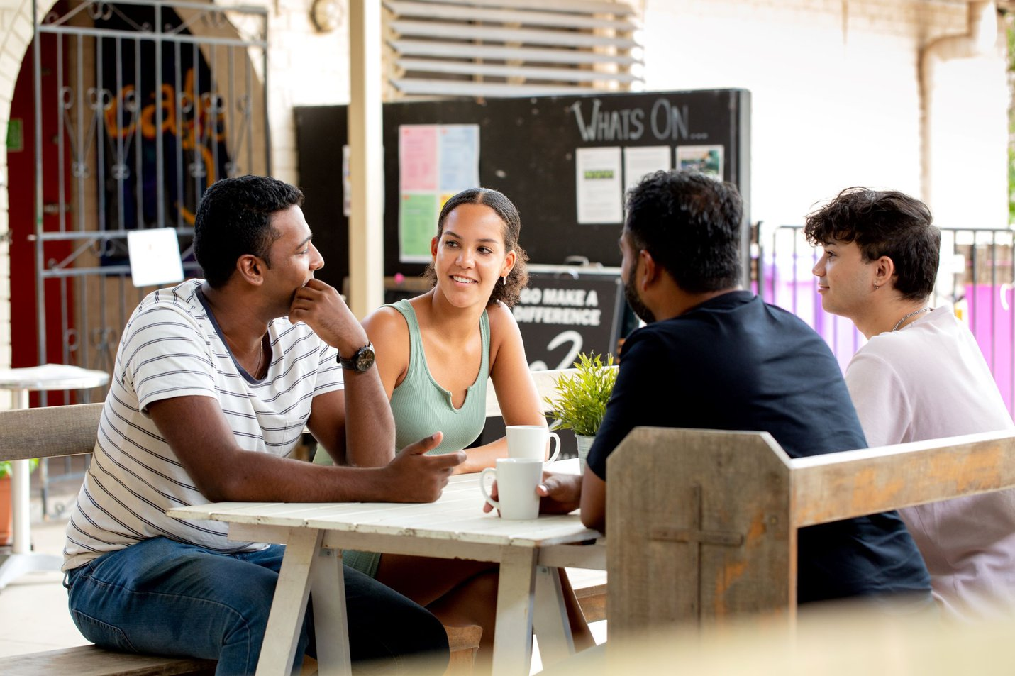 group_mentoring_table_discussion_outside_table.jpg
