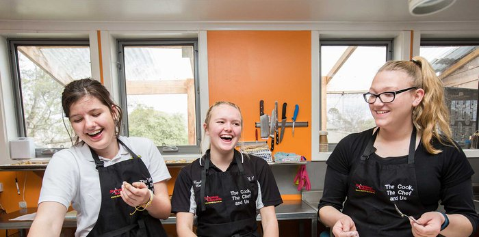 Students laughing in the kitchen