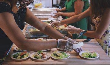 volunteer article food preparation masks hands group abstract header